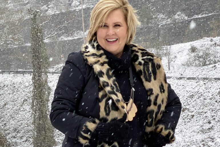 playing in the snow with a faux fur coat