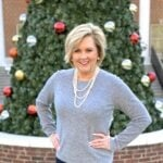 Fashion Blogger 50 Is Not Old wearing a classic cashmere sweater and a pearl necklace