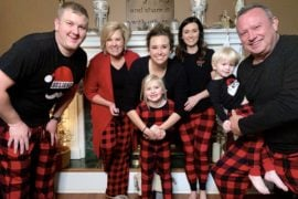 family photo in buffalo plaid pajamas