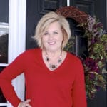 a red v neck sweater with a leopard print necklace worn by Fashion Blogger 50 Is Not Old