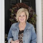 For the month of love, fashion blogger 50 Is Not old is wearing a denim jacket and a leopard camisole