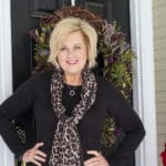 Fashion blogger 50 Is Not Old shows us a classic black sweater dress