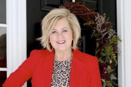 Fashion Blogger 50 Is Not Old is wearing a bright red blazer and a leopard print top to a Galentine party