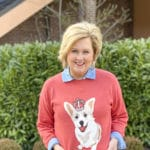 Fashion Blogger 50 Is Not Old is styling a coral sweater that has a Corgi dog on it by Time and Tru from Walmart