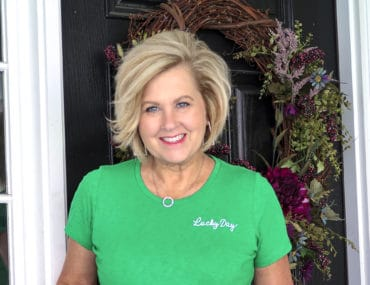 Fashion Blogger 50 Is Not Old wearing a bright green lucky day t-shirt