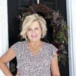 Fashion Blogger 50 Is Not Old is looking cutesy in her leopard print flutter sleeve top