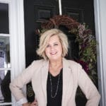 Fashion Blogger 50 Is Not Old in a taupe Ponte knit blazer, a black v-neck t-shirt