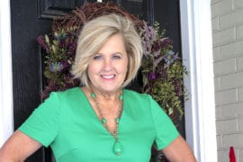 Fashion Blogger 50 Is Not Old is wearing a gorgeous bright green sheath dress