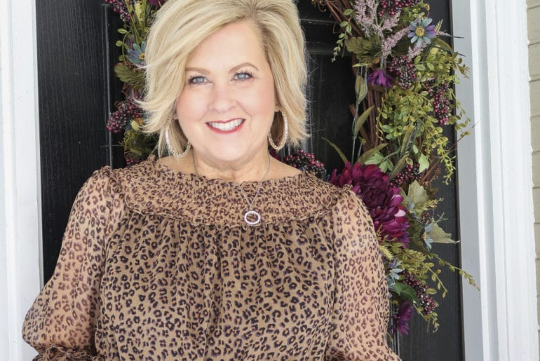 Fashion Blogger 50 Is Not Old wearing a sexy leopard print top