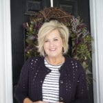 Fashion Blogger 50 Is Not Old is wearing a striped t-shirt with a navy crochet cardigan
