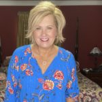 Fashion Blogger 50 Is Not Old is wearing a bright blue floral top