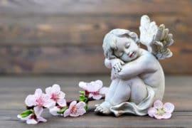 Angel guardian sleeping with flowers