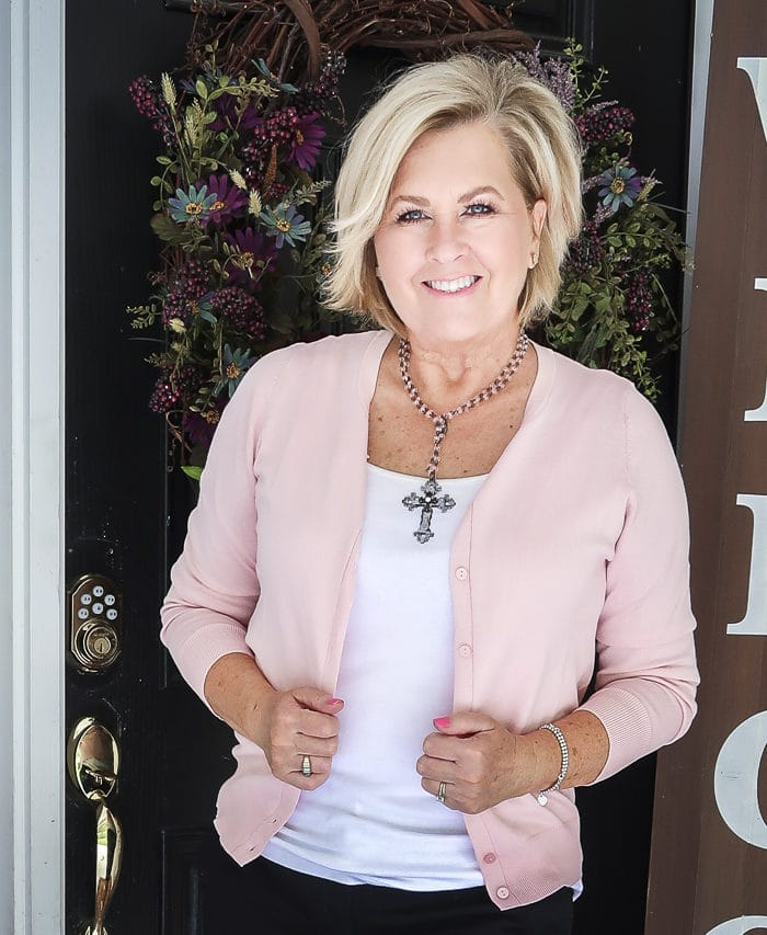 Fashion Blogger 50 Is Not Old is wearing a soft pastel pink cardigan from Walmart