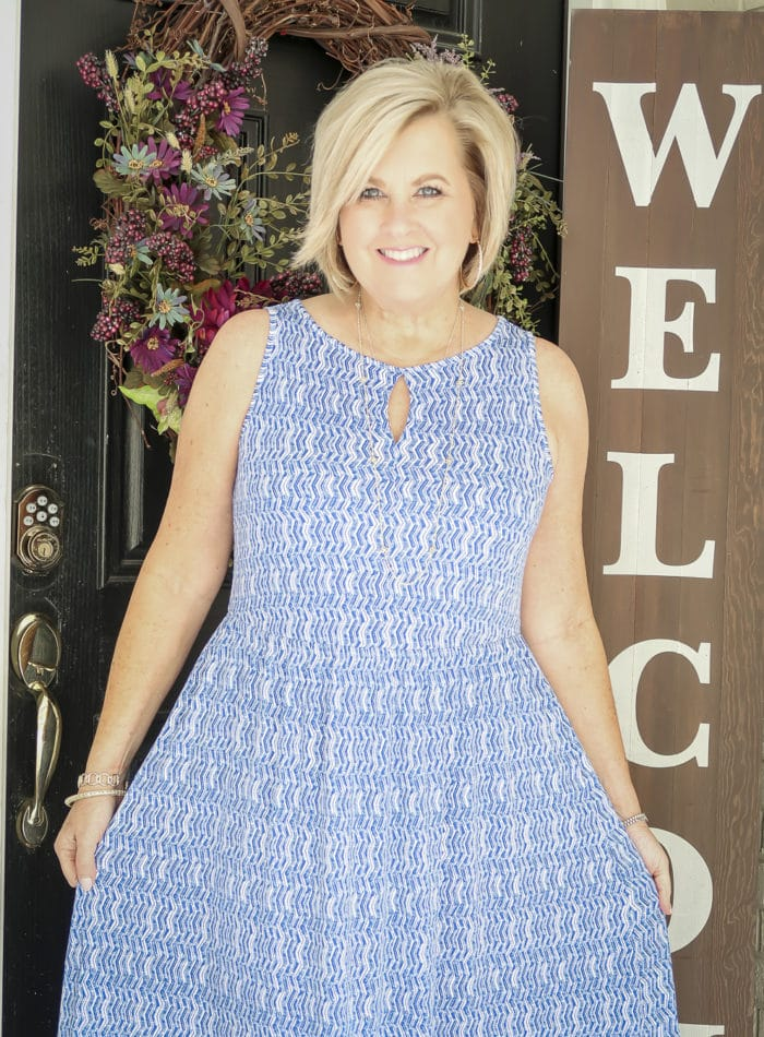 Fashion Blogger 50 Is Not Old wearing a blue and white tiered sleeveless maxi dress
