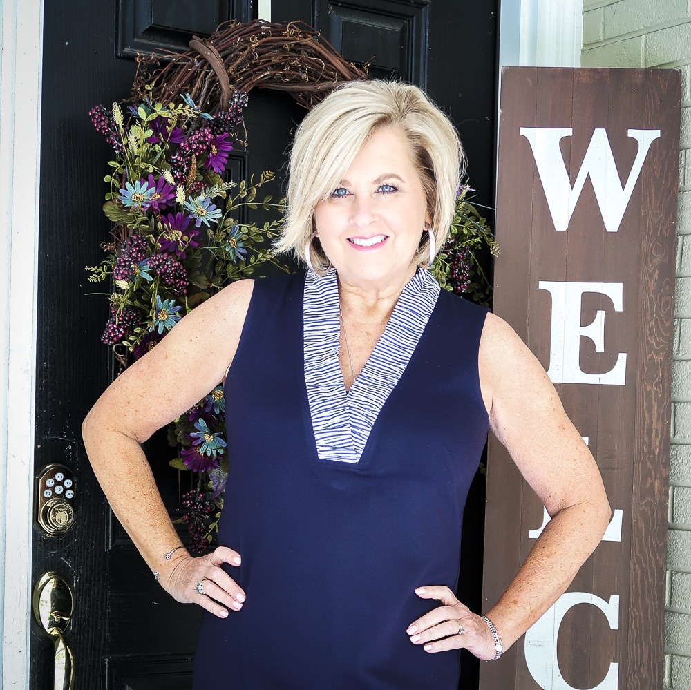 Fashion Blogger 50 Is Not Old is celebrating turning 60 with a navy sheath dress from Eliza J