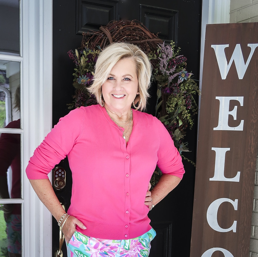 Fashion Blogger 50 Is Not Old is wearing a racy pink cardigan from Walmart
