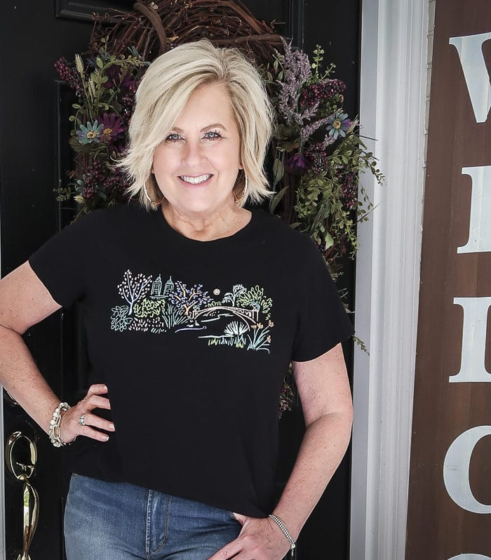 Fashion Blogger 50 Is Not Old is wearing a black graphic tee from Old Navy