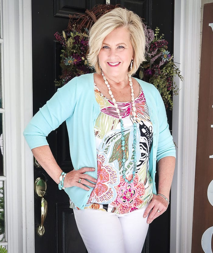 Fashion Blogger 50 Is Not Old is looking summery in an aqua cardigan, a bright tropical top