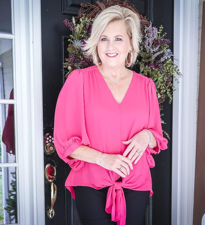 Fashion Blogger 50 Is Not Old is styling a gorgeous pink front-tie blouse