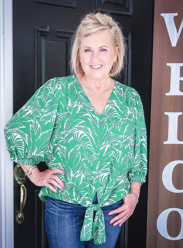 Fashion Blogger 50 Is Not Old is wearing a green palm print blouse