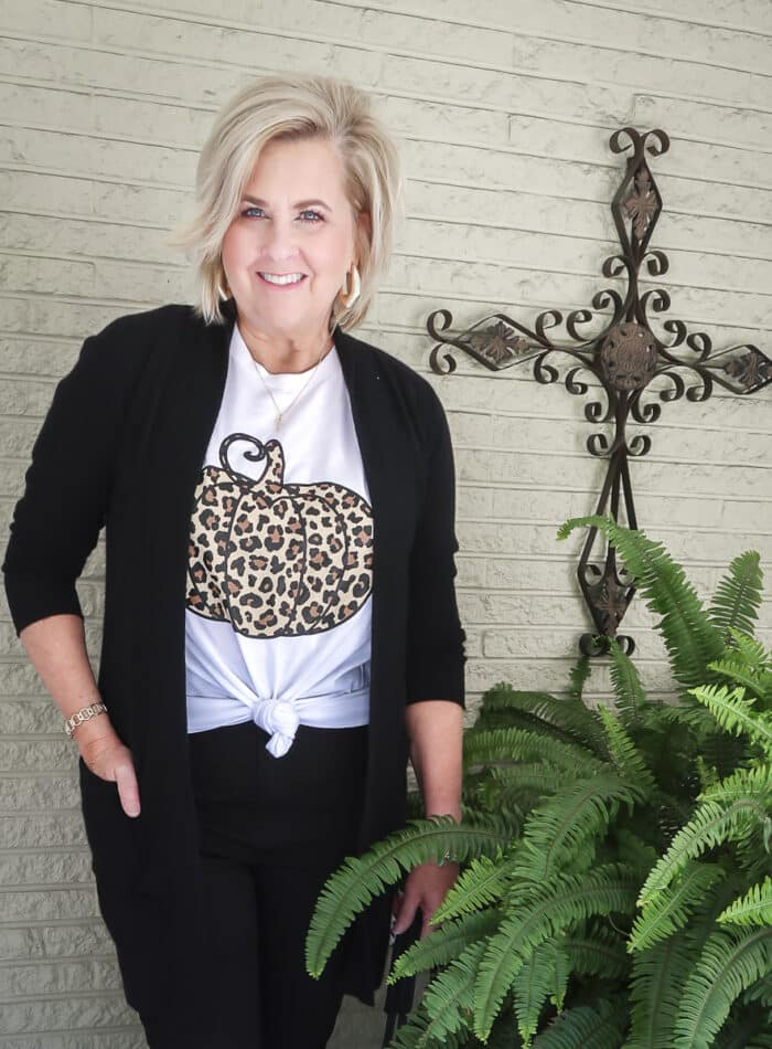 Fashion Blogger 50 Is Not Old is wearing a leopard print pumpkin t-shirt with a long black cardigan and black skinny jeans