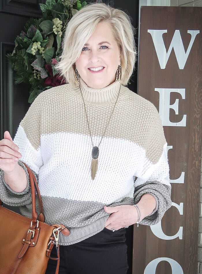 Fashion Blogger 50 Is Not Old is wearing a colorblock sweater