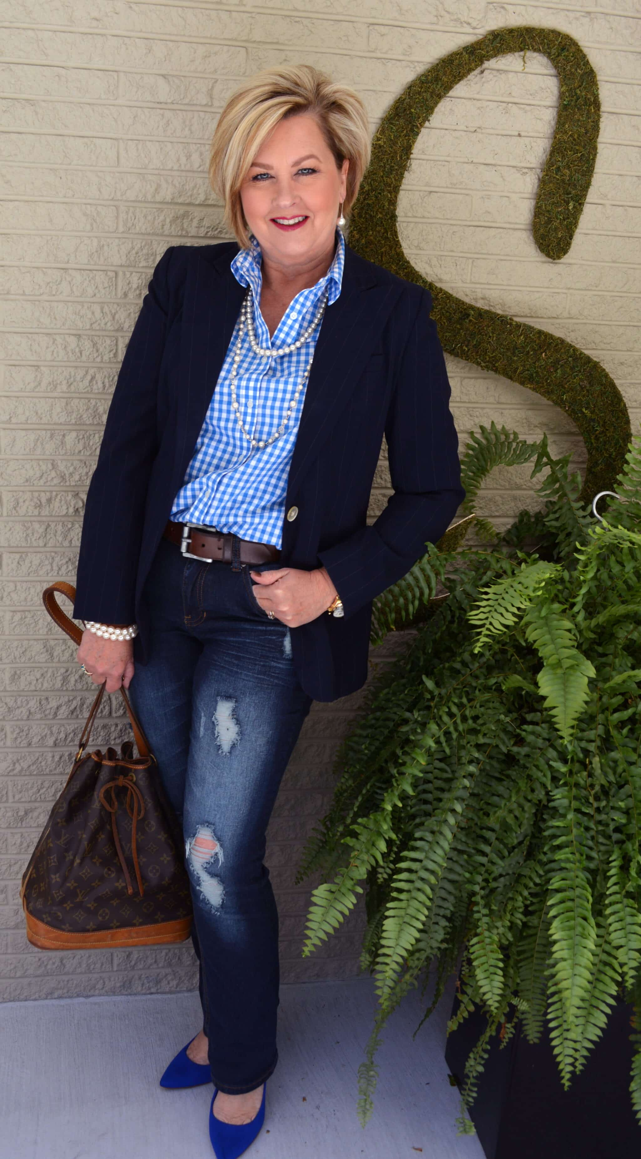 Fashion Blogger 50 Is Not Old in distressed jeans and pearls in 2015