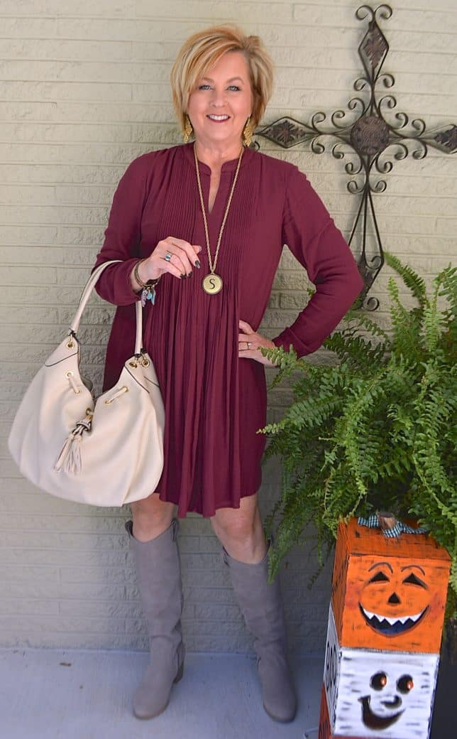 Gray knee boots with a pintucked dress worn by Fashion Blogger 50 Is Not Old