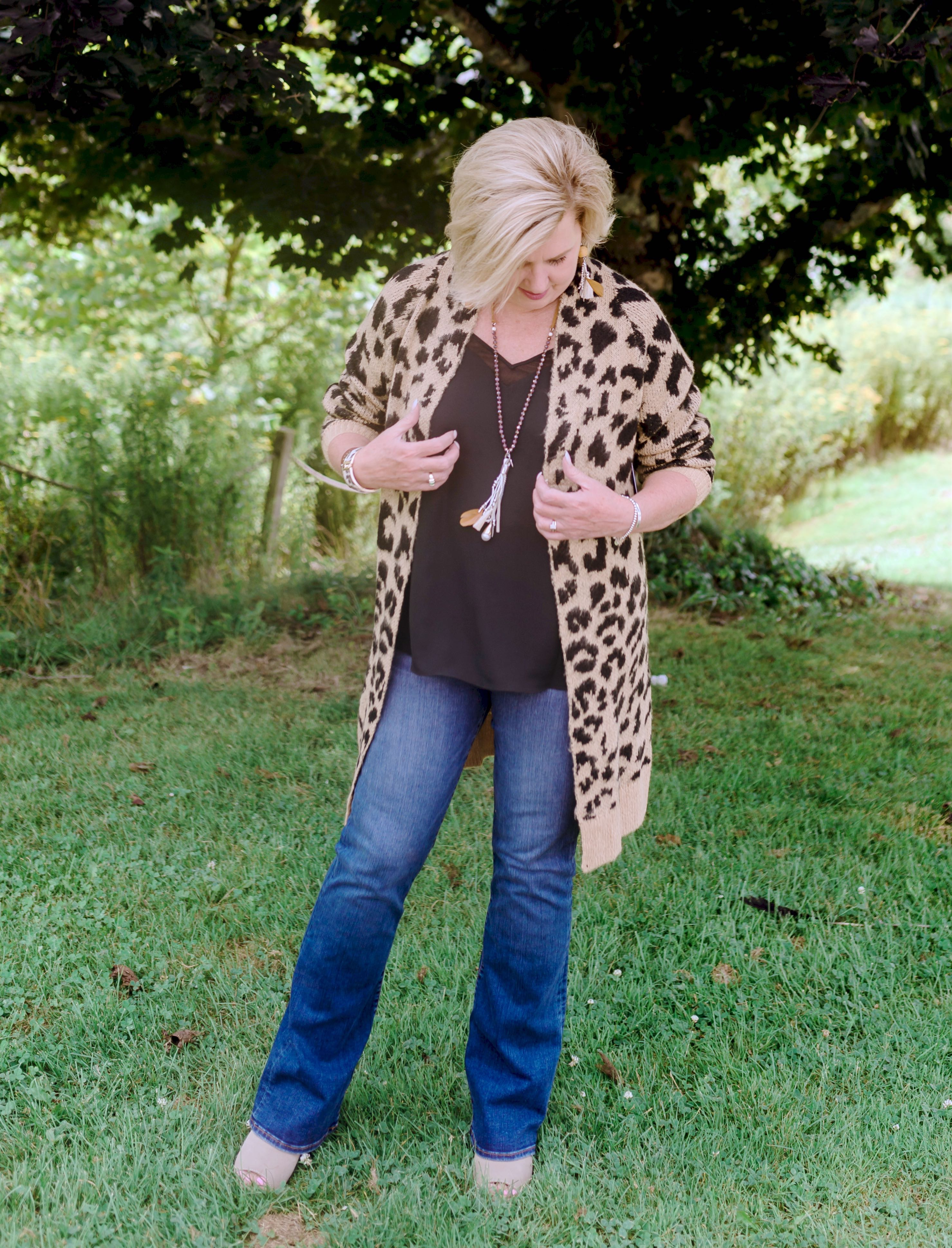 Fashion Blogger 50 Is Not Old in a leopard print sweater and bootcut jeans