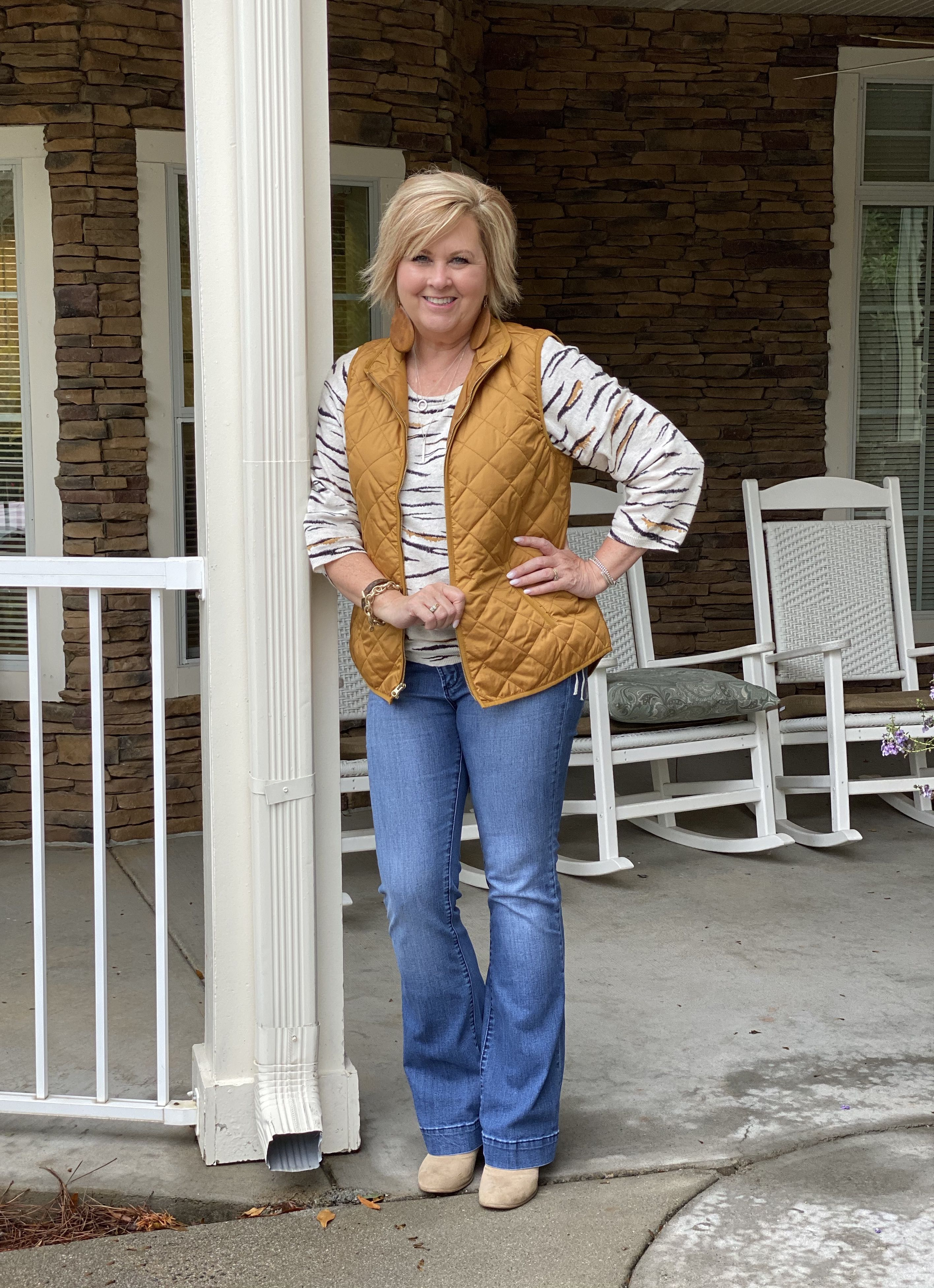 Fashion Blogger 50 Is Not Old in a tiger stripe sweater and a quilted vest