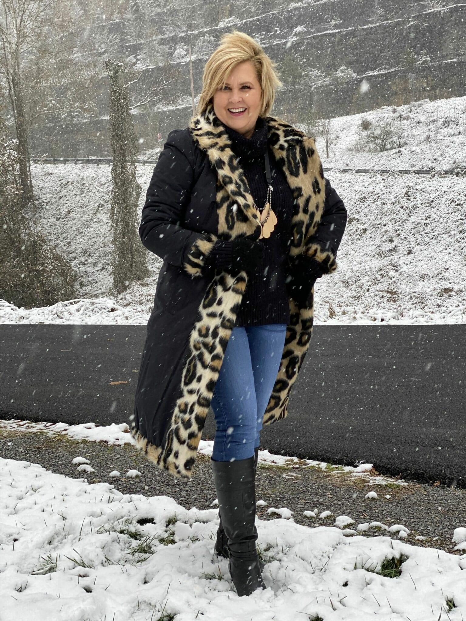 Fashion Blogger 50 Is Not Old in a Reversible coat with leopard fur trim