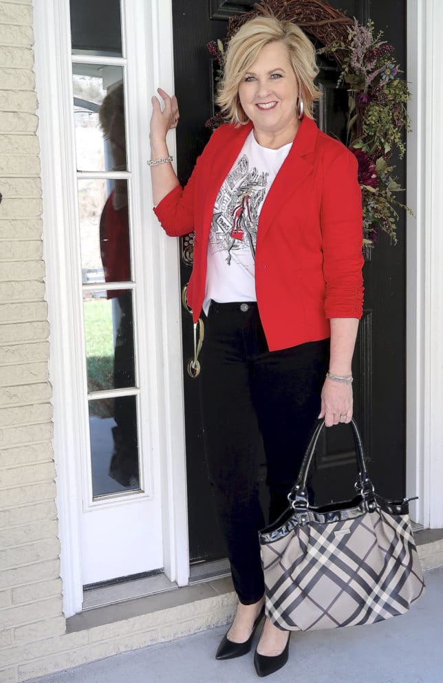 Fashion Blogger 50 Is Not Old looks stylish in a graphic tee