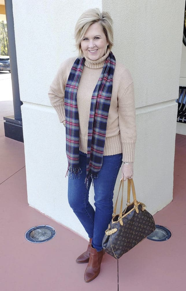 Fashion Blogger 50 is not old wearing a turtleneck and a plaid scarf with jeans