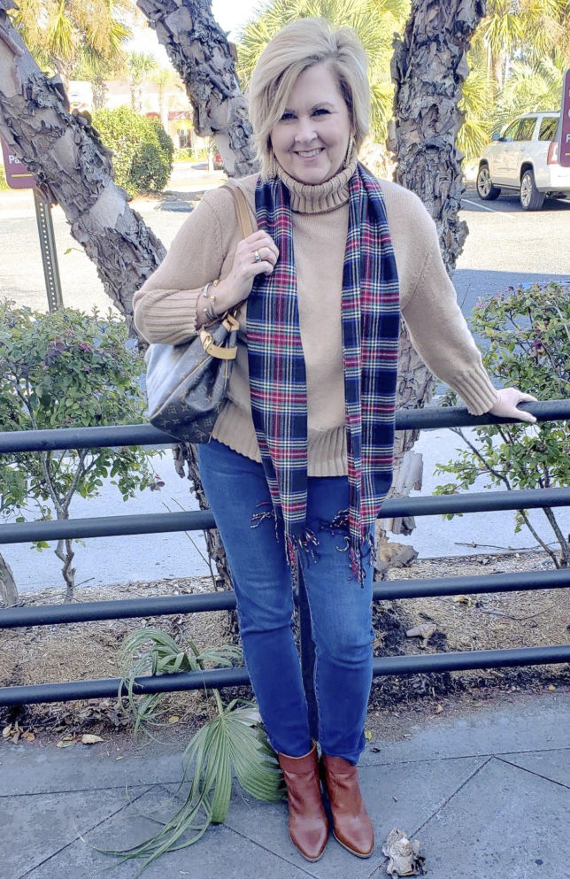 Fashion Blogger 50 is not old wearing a beige turtleneck, a plaid scarf and jeans