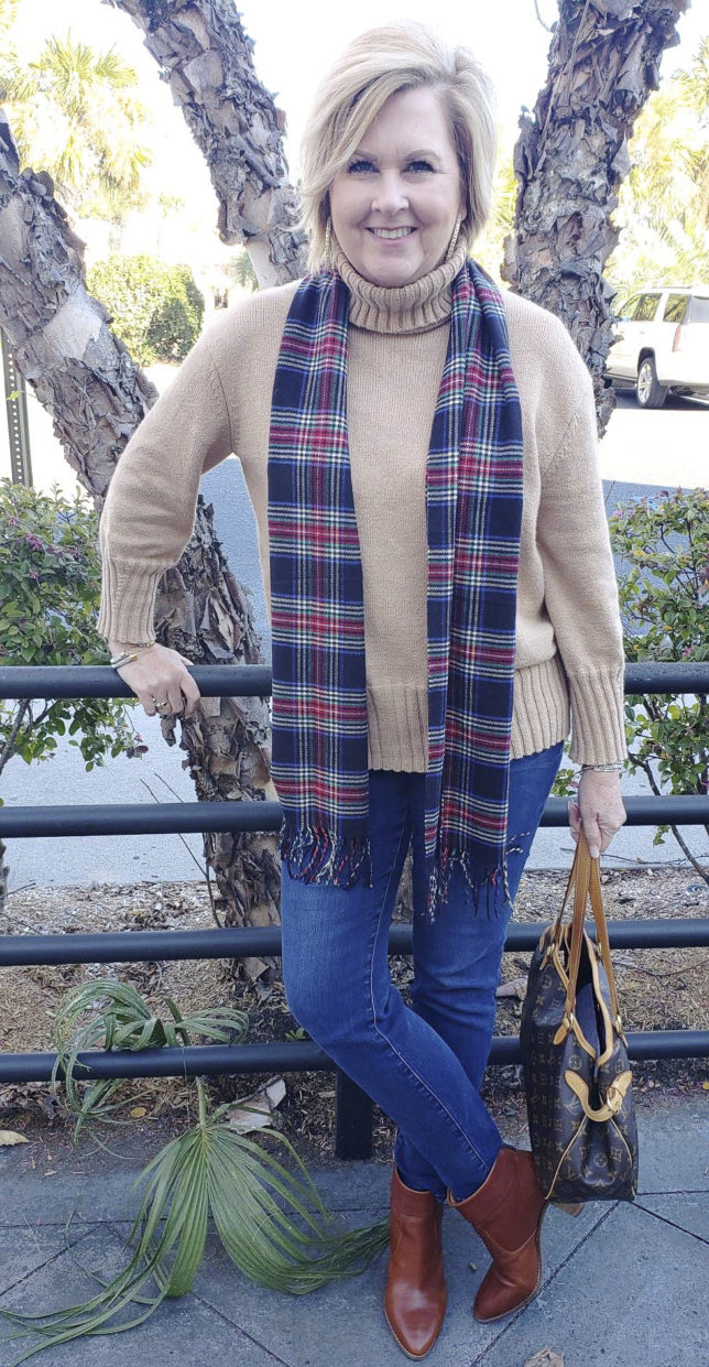 Fashion Blogger 50 is not old wearing a beige turtleneck and a plaid wool scarf