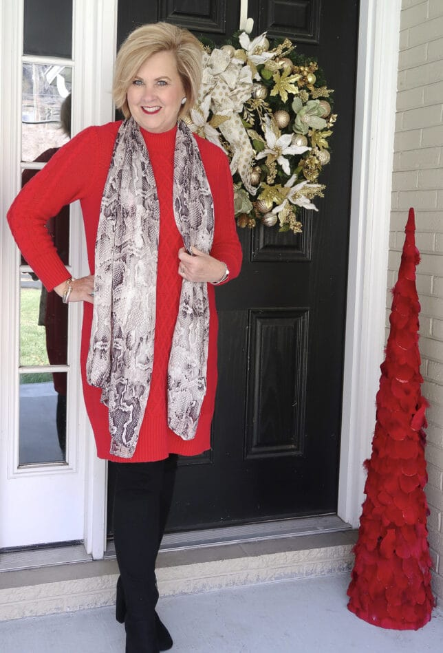 Fashion Blogger 50 is not old wearing a red sweater dress and a snakeskin scarf