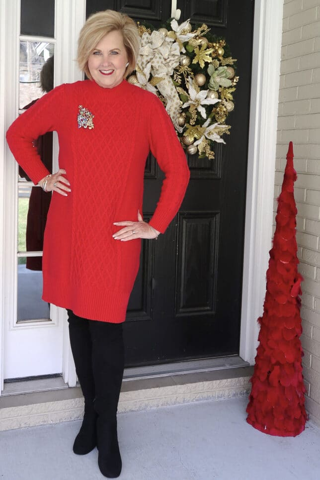 Black over the knee boots with a red sweater dress worn by Fashion Blogger 50 Is Not Old