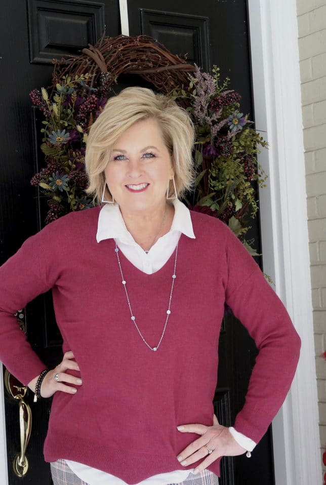 Fashion Blogger 50 Is Not Old is wearing a magenta v neck sweater in a solid color