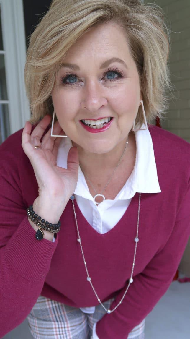 Fashion Blogger 50 Is Not Old is wearing silver geometric earrings from Kendra Scott