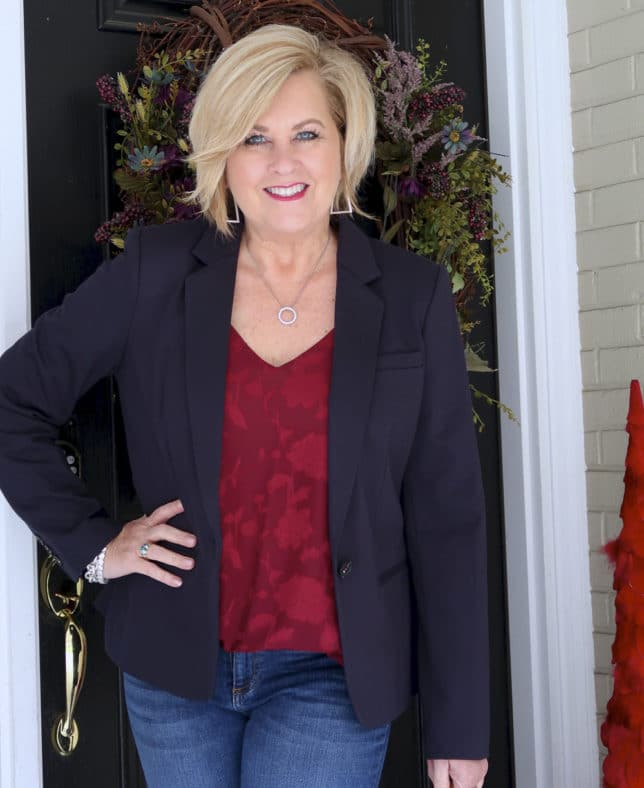 A floral burgundy camisole, and a navy blazer makes a great look