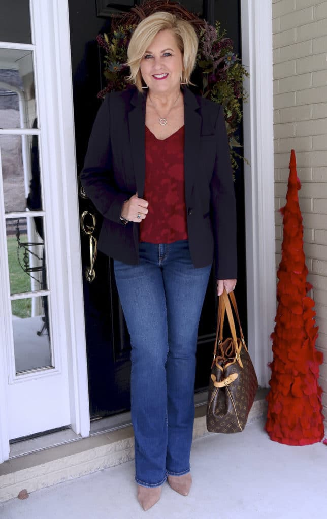 Flare jeans, pointy boots, a burgundy camisole, a Louis Vuitton satchel, and a navy blazer makes a great look
