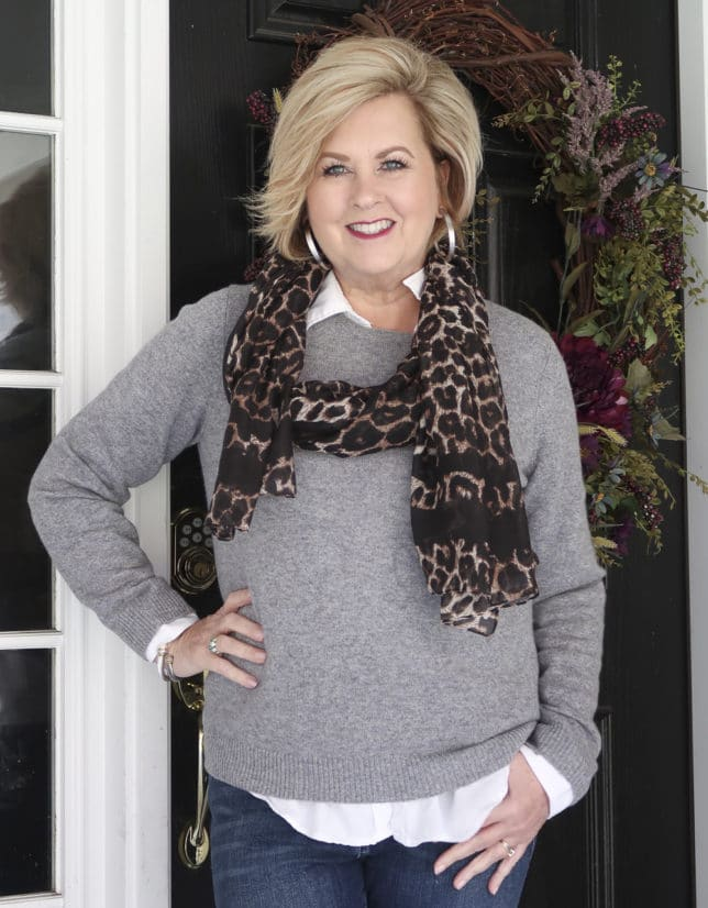 Fashion Blogger 50 Is Not Old is mixing a classic cashmere gray sweater and a leopard scarf