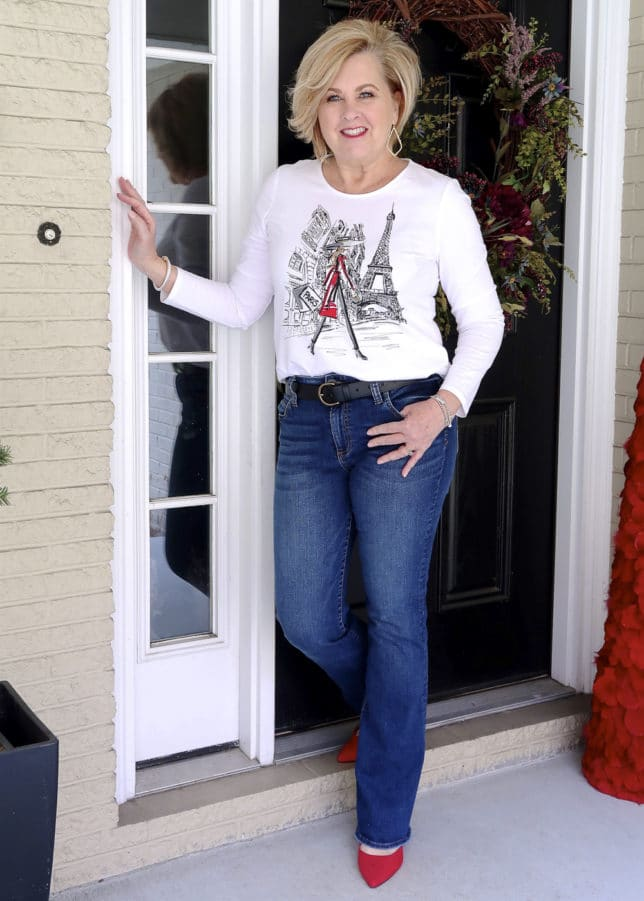 FASHION BLOGGER 50 Is Not Old styles a graphic Paris tee tucked into jeans