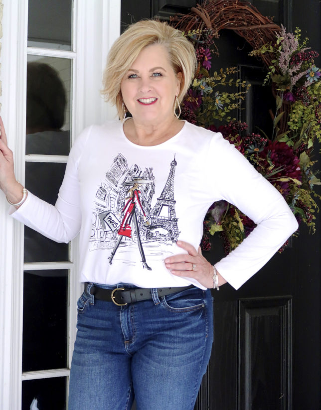 FASHION BLOGGER 50 Is Not Old wears a graphic long sleeve Paris tee