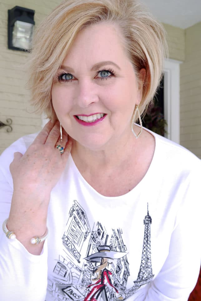 FASHION BLOGGER 50 Is Not Old showing Kendra Scott earrings