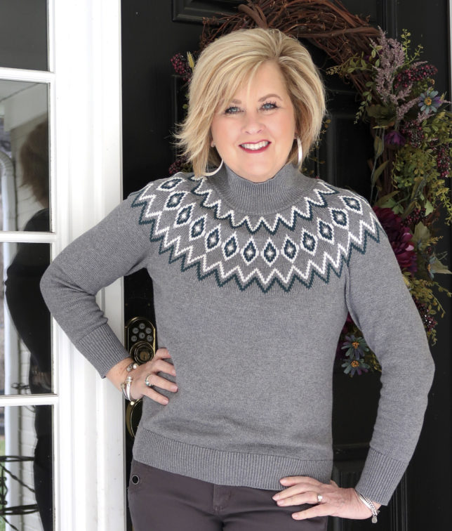 Fashion Blogger 50 Is Not Old is wearing a gray Fairisle sweater