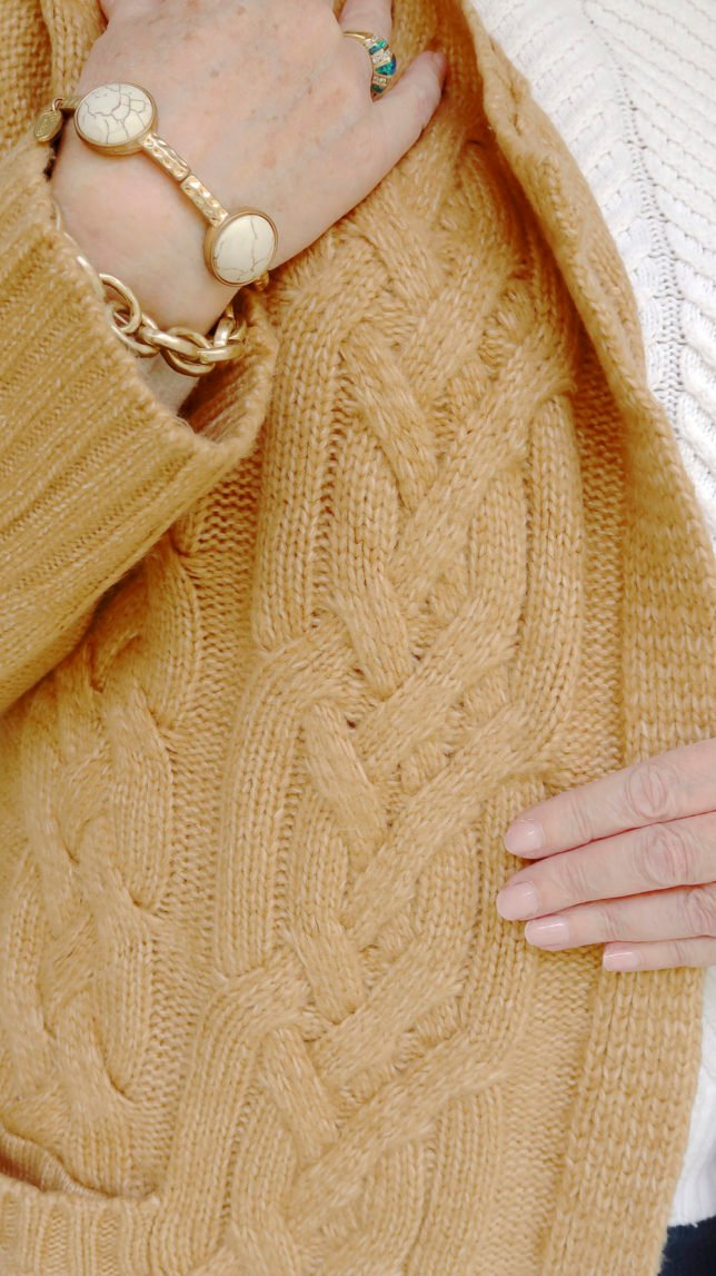 Fashion Blogger 50 Is Not Old is showing a neutral cable knit cardigan in tan