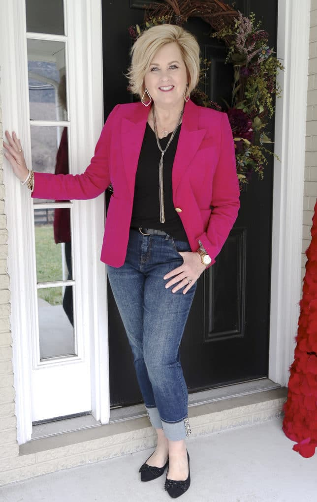 Bright pink jacket with a black t-shirt and jean worn by Fashion Blogger 50 Is Not Old