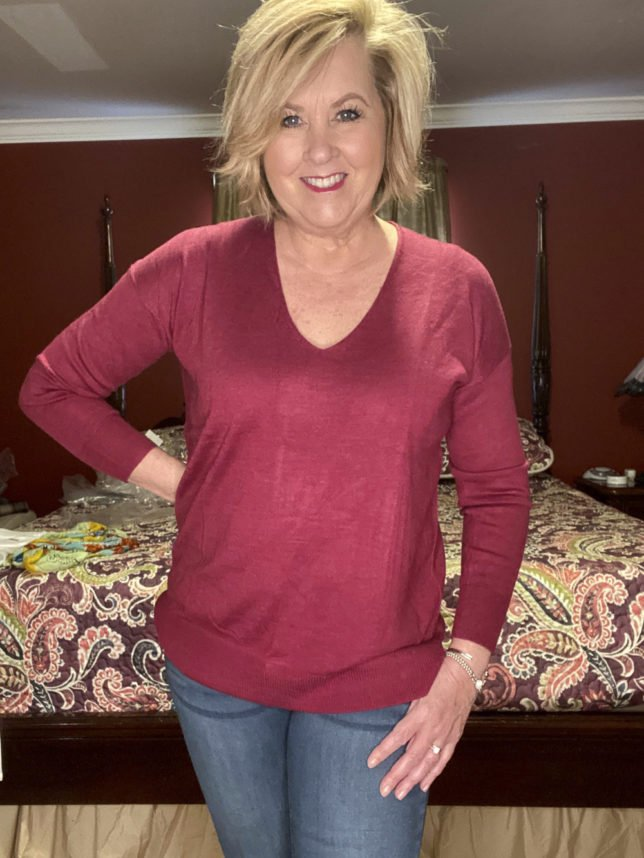 The Loft try on session with blogger 50 Os Not Old is wearing a pullover v-neck magenta sweater