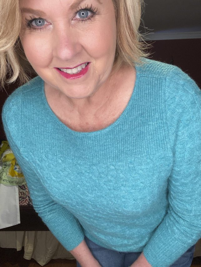 The Loft try on session with blogger 50 Os Not Old is a blue cable knit sweater